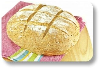 Irish soda bread. Round loaf with cross.