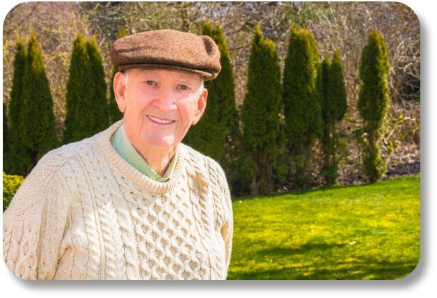Irish Wool Sweaters - Smiling Man in Sweater and Cap