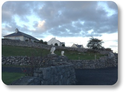Irish Expressions - Farmhouse with stone wall and interesting cloudcover.