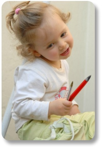 Irish baby girl names.  Adorable little girl with pencils.