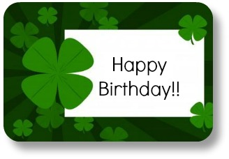 Irish birthday blessings.  Shamrock cupcake with candle.