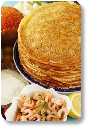 Shrove Tuesay pancakes.  Large stack with a variety of toppings.