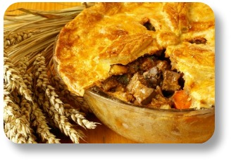 Steak and guinness pie.  Round baking dish, slice removed.