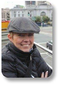 Wool tweed cap.  On lady staying warm.
